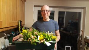 John with tray of posies